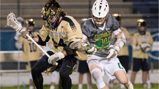 The Gulf Breeze Dolphins took to the top of District 1 with a 9-6 win over Catholic, but it came with the loss of sophomore TJ Caldwell to a foot injury.