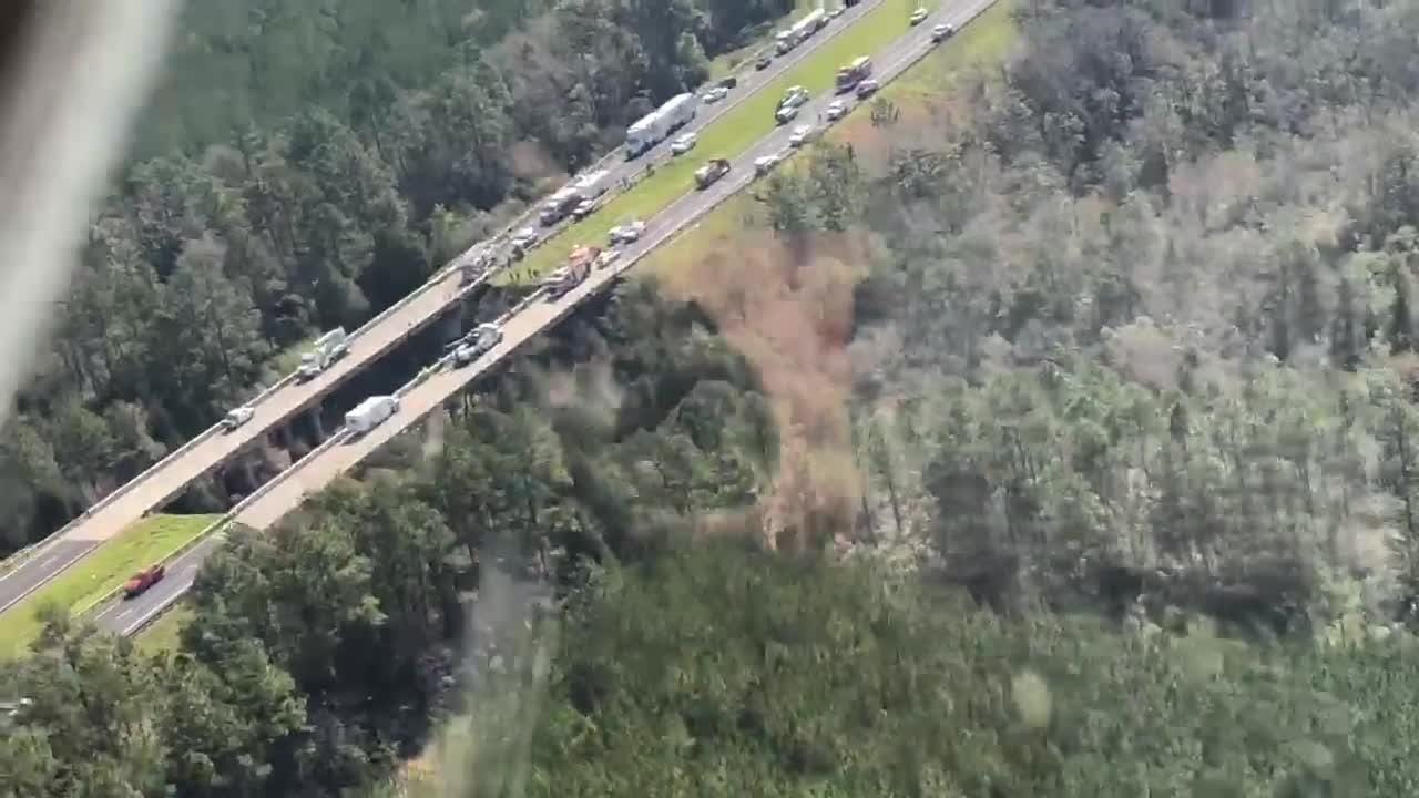 Aerial footage shows tour bus crash in Alabama