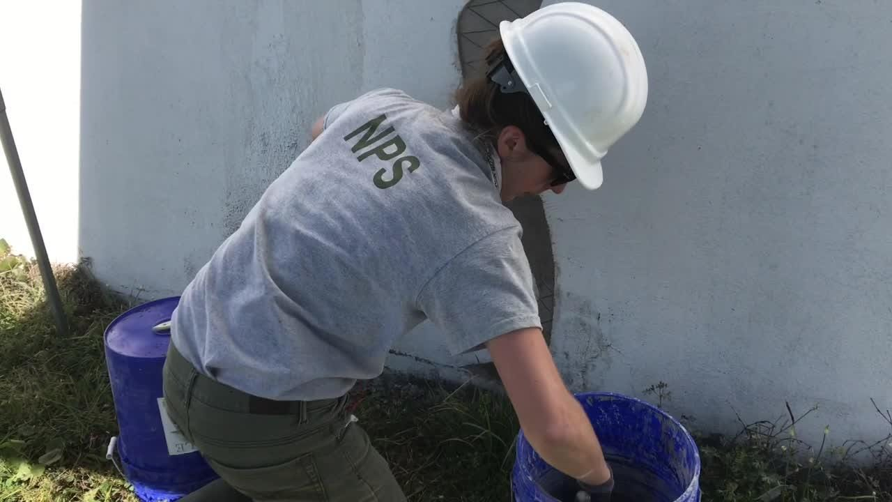 National Park Service team's does repair work at Battery San Antonio on Pensacola Naval Air Station.