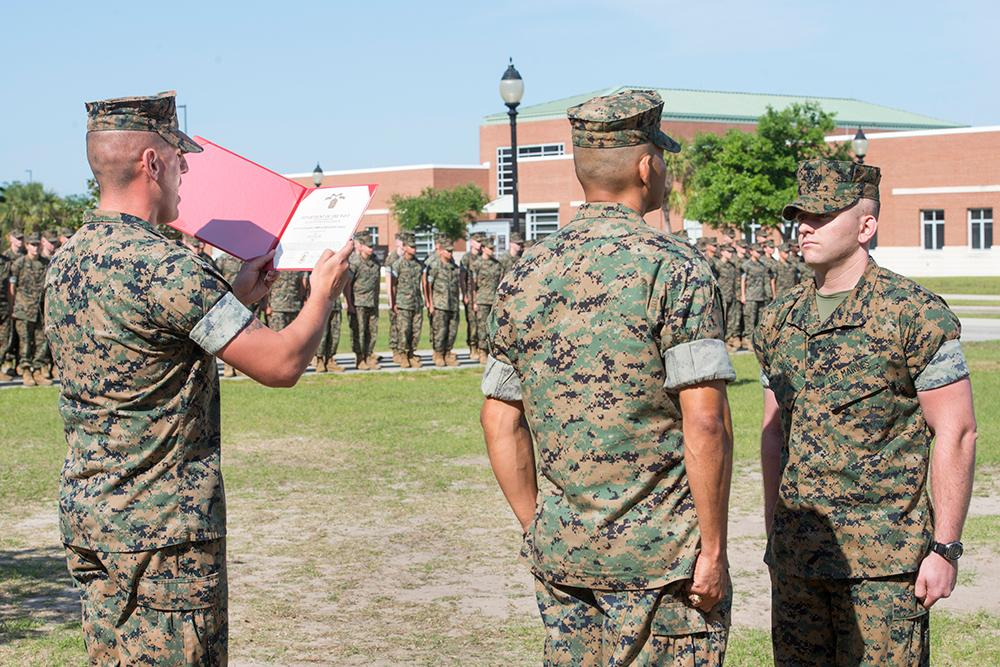 Marine Sgt. Tyler Harman is presented the Navy & Marine Corps Achievement Medal during a ceremony at the Pensacola Naval Air Station on April 12, 2018.  Harman saved his 2-year-old neighbor Rylan Strother's life when he was choking on a grape.