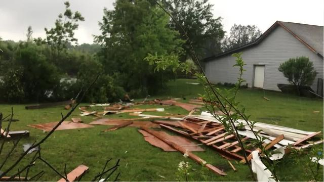 Debris and property damage were found in Molino after a possible tornado accompanied storms on Sunday.