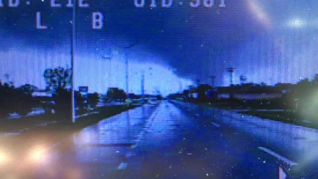 Footage from a police officer's dash cam shows a tornado in Foley, Alabama during Sunday's string of storms.