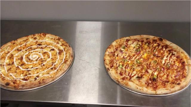 Graffiti Pizza, a New York-style pizza-by-the-slice restaurant, opens later this month. Here's a look at what's going on in the kitchen and on the walls.