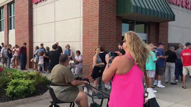 People line up to buy eclipse glasses at Hy-Vee