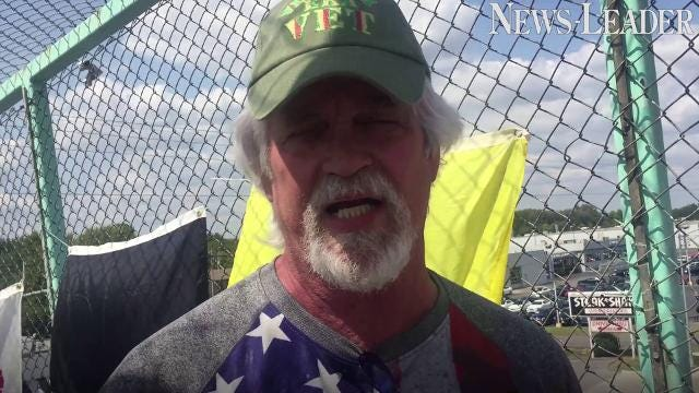 Here's why people with flags are on the bridge over Campbell Avenue