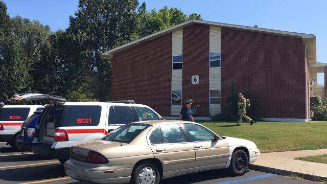 Authorities respond to a fire at the John B. Hughes apartment complex.