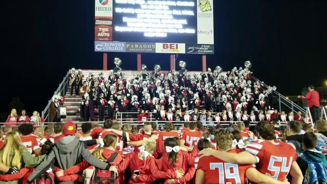 The Webb City football team and fans celebrate together after a district championship victory over Carl Junction.