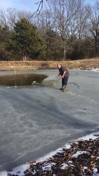 Marshfield resident Jeff Mann saves his neighbor's dog from his frozen pond in his backyard.