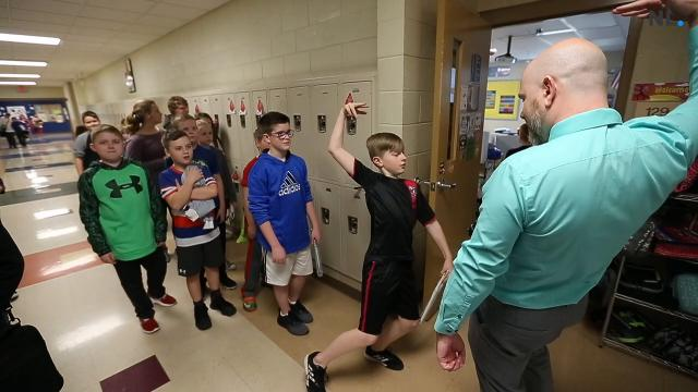 Fifth-grade teacher Joshua Kennedy greets each student with their own handshake at the beginning of every class at Wilson's Creek Intermediate School.