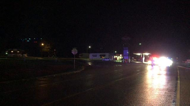 Emergency vehicles leave the scene in Fair Grove after a deputy drowned late Friday night.