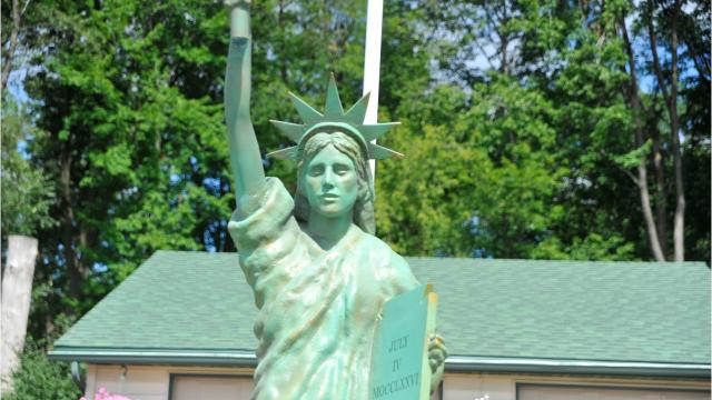 Helen Haydock said her husband has always dreamed of having a replica of the Statue of Liberty in the yard of their Wisconsin Rapids home. The couple found Dave Oswold, owner of D. W.O. Fiberglass in Sparta, and asked him to make them one. The statue was installed in the front yard of their Second Avenue home Friday.