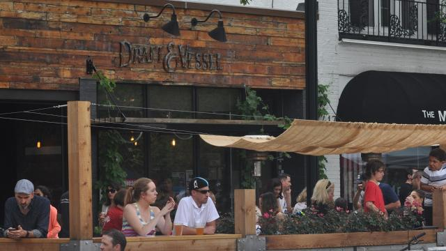 When Three Lions Puband Camp Bar introduced on-street patio decks last year, they unknowingly started a trendthat has rippled down Oakland Avenue.
