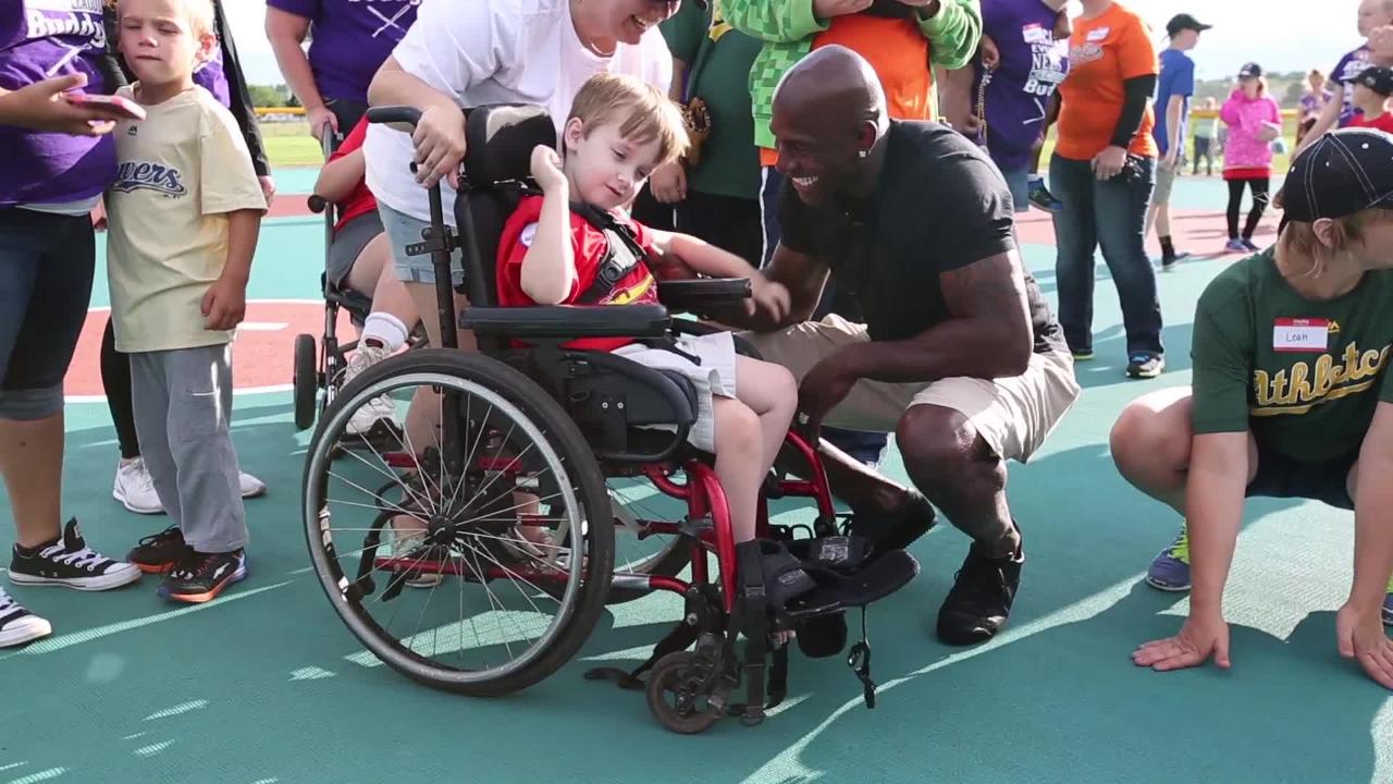 Donald Driver stops to meet and thank his fans in the Miracle League of the Lakeshore before their all-star game in Manitowoc where he threw out the first pitch.