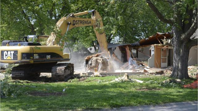 The Green Bay Packers have begun demolishing houses on the south side of the Titletown District to clear land for a future townhouse development