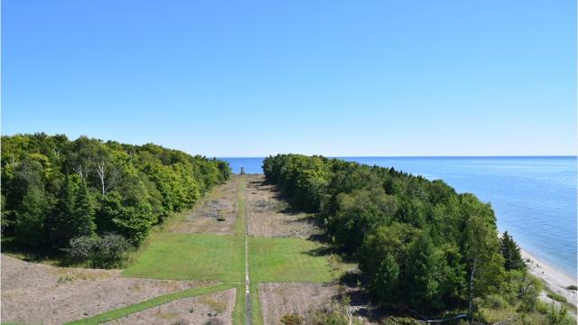 USA TODAY NETWORK-Wisconsin reporter Patti Zarling spent the weekend clearing brush, hauling wood and building a sign as a volunteer for Friends of Plum and Pilot Islands Aug. 12. Here's a look at her experience.