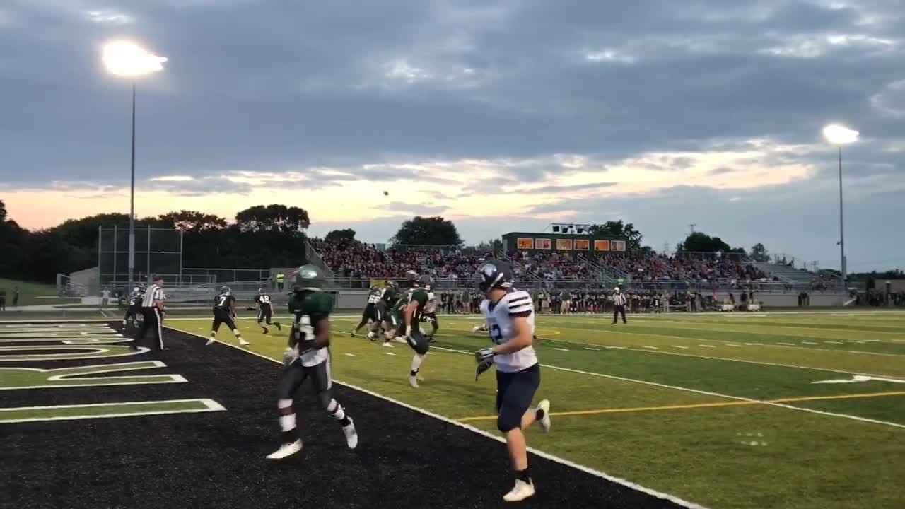 Brookfield East quarterback Sam McGath throws a touchdown to Patrick Cartier just before halftime in a 25-6 win over Wauwatosa West on Aug. 18.
