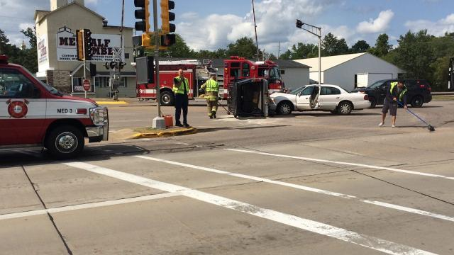 Two people were alert and walking following a two-vehicle crash at the intersection of Riverview Expressway and West Grand Avenue Wednesday afternoon about 3 p.m.