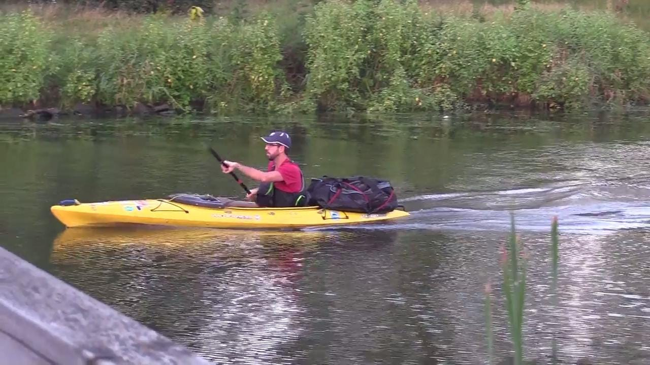 Justin McArthur of Fond du Lac makes his way out of Asylum Bay kayaking on day two of his four day journey around Lake Winnebago, Tuesday, August 29, 2017.  McArthur is doing it as a personal goal for Paddle Everything as well as for Camp to Belong.