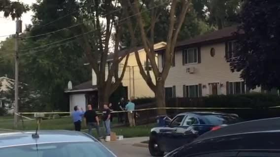 Police converge on an apartment complex as they investigate a death.