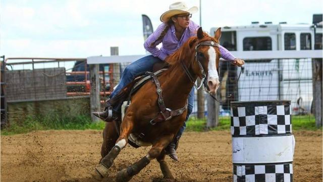 Olivia Helminiak of Stevens Point and her horse, Slys Ace In The Hole, recently won the open division at the National Barrel Horse Association's state finals.