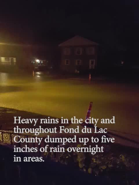 Heavy rainfall causes street flooding in Fond du Lac.