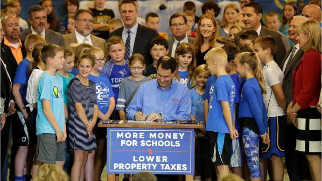 Gov. Walker signs $76 billion state budget