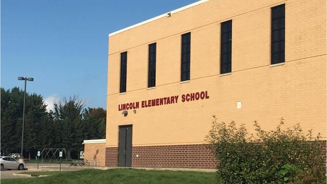 "Pam Nikolai, a former music teacher at Lincoln Elementary School, was accused of telling two boys they couldn't play Lincoln in a class skit because they were ""too dark-skinned."""