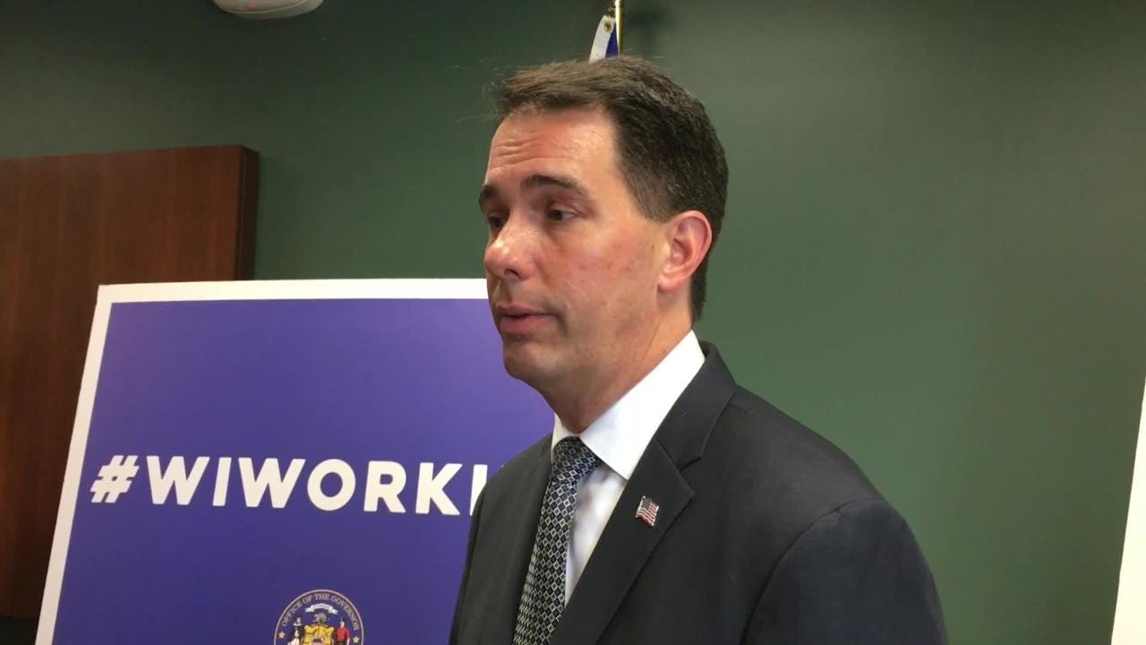 Gov. Scott Walker said he will stand and put his hand over his heart for the national anthem during Thursday's game between the Green Bay Packers and Chicago Bears. Sept. 27, 2017.