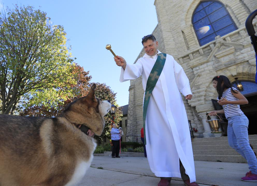 About 20 people gathered outside St. Mary of the Angels Catholic Church in Green Bay Saturday for an annual pet blessing.