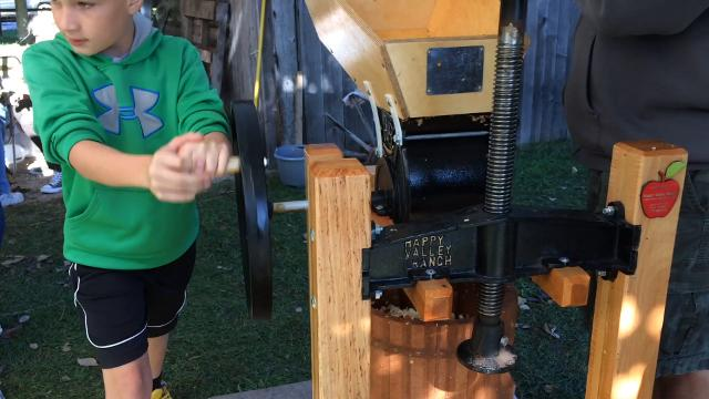 Visitors of Washington Island's Fall Fun Fest/Cider Pressing Party had the opportunity to learn how to make apple cider with a press