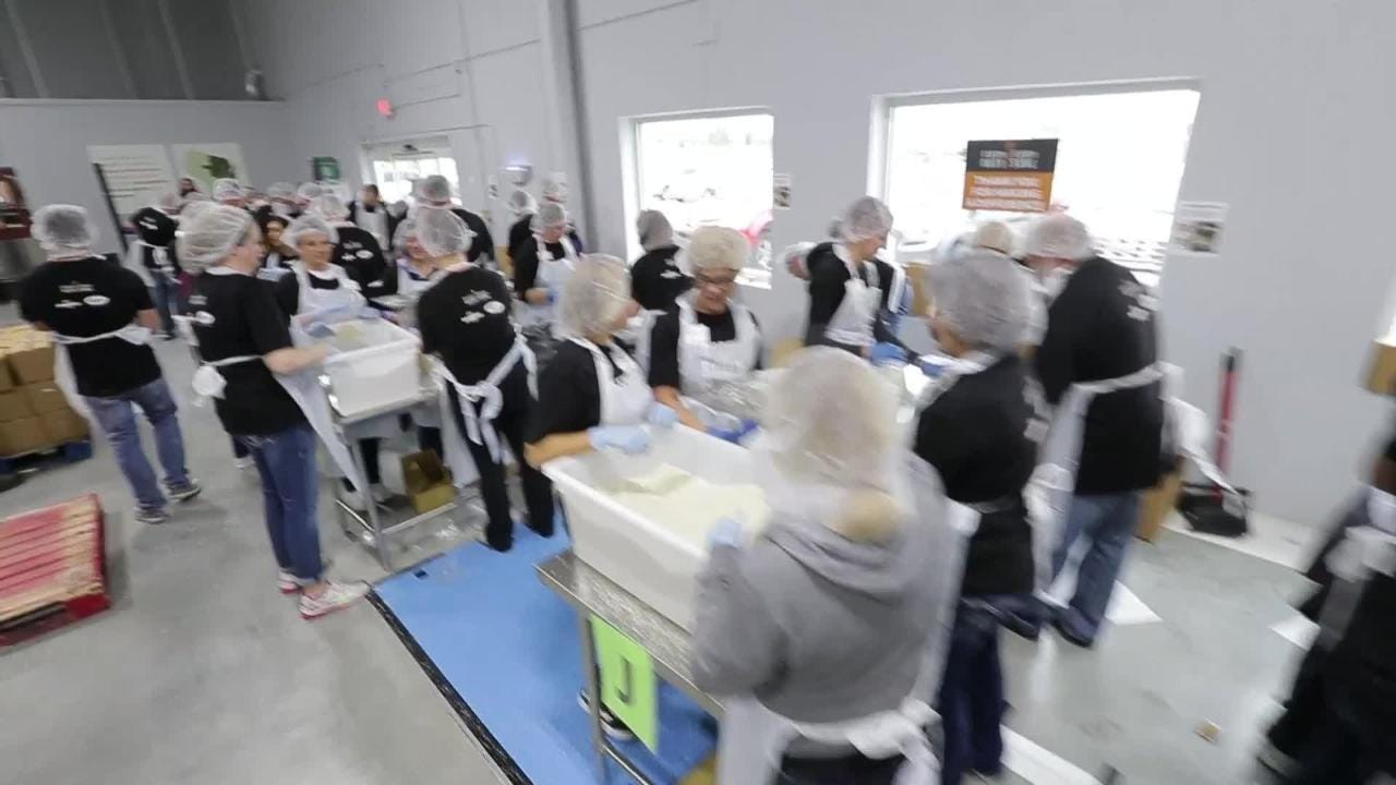 Volunteers collaborate to re-pack 252,000-lbs of bulk rice during a 24-hour period at Feeding America Eastern Wisconsin in Appleton.