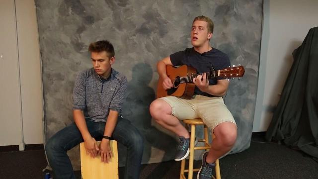 Local musicians Joshua Guy and Eric Reid perform their song
