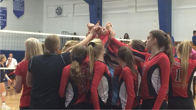 Newman Catholic sweeps Columbus Catholic in Division 4 sectional semifinal.
