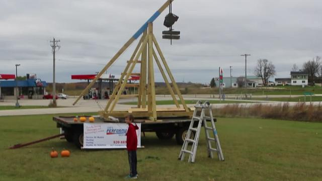 Leif Peterson builds medieval siege engine and chucks pumpkins at Plymouth Alliance Church.