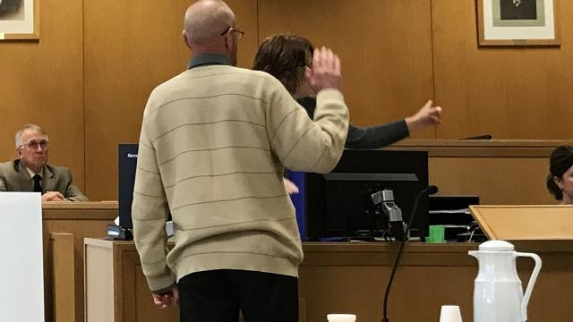 Mark Kusters, charged with first-degree intentional homicide for the 2016 shooting death of Richard Flynn, took the stand Tuesday in his own defense. Kusters said he didn't mean to shoot Flynn, but that his wife, Trina, pulled his collar and caused the shotgun Kusters was carrying to fire.