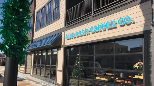 & Streetwise: Blue Door Coffee Co. forks over all profits to charity