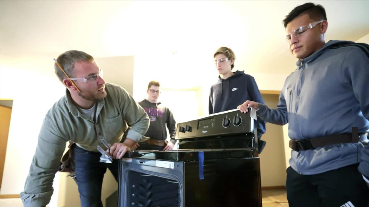 A group of 22 students from all three Appleton high schools took part in a construction class that involved building a home for Habitat for Humanity.