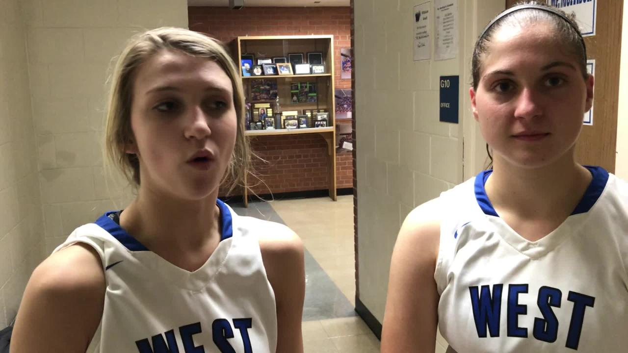 Oshkosh West's Callista Rochon-Baker (left) and Kendra Davis talk about the Wildcats win over Oshkosh North on Friday night.