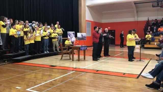 Gov. Scott Walker signs the bill for Dillon's Law at Mishicot High School. (Dec. 11, 2017)
