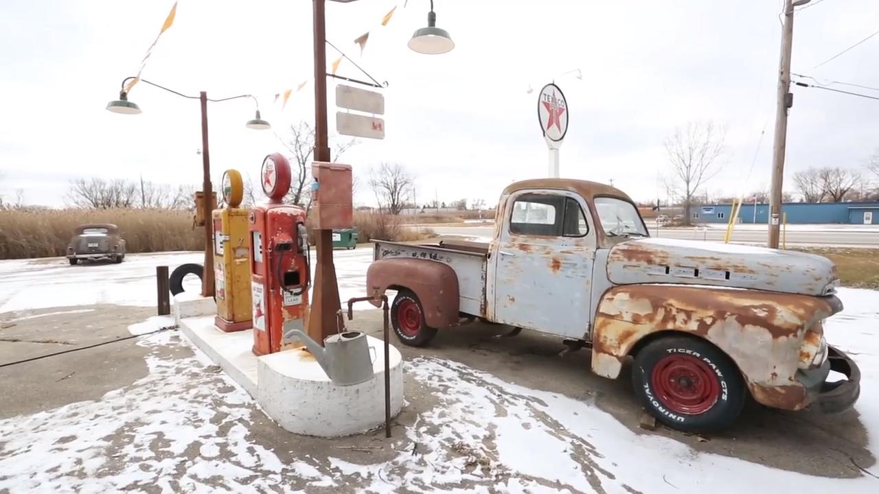 Bob Norris took his love of old cars and antiques and built a 1950s style gas station scene outside his Fond du Lac business.