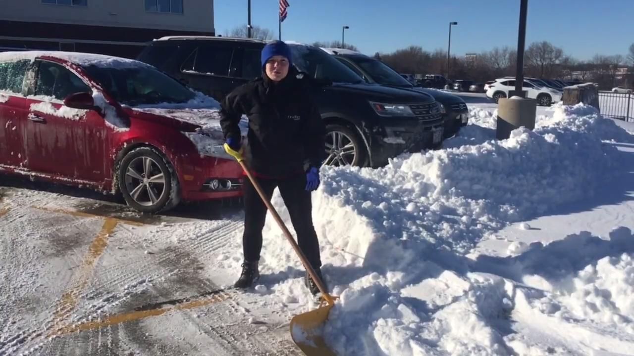 Dr. Amy Romandine Kratz, of Prevea Health, demonstrates the proper way to shovel to avoid injury.