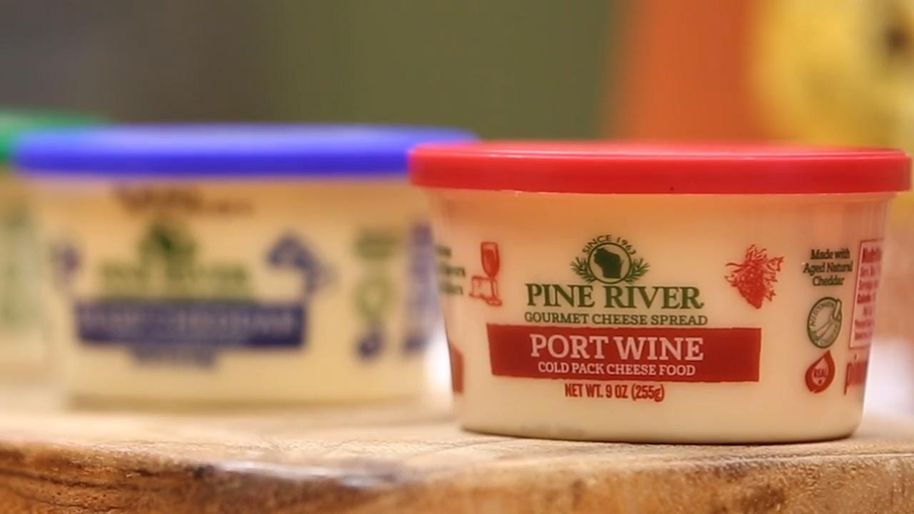 Manitowoc County's Pine River Pre-Pack makes award-winning cheese spreads. Take a look inside the facility to see how it turns blocks of cheese into some of Wisconsin's favorite spreads.