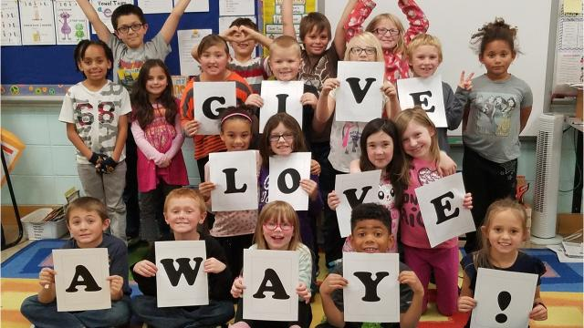 """Second-grade students at Mead Elementary Charter School created a video using the song """"Give Love Away"""" by Noelle Maracle to influence others to spread kindness and stop bullying."""
