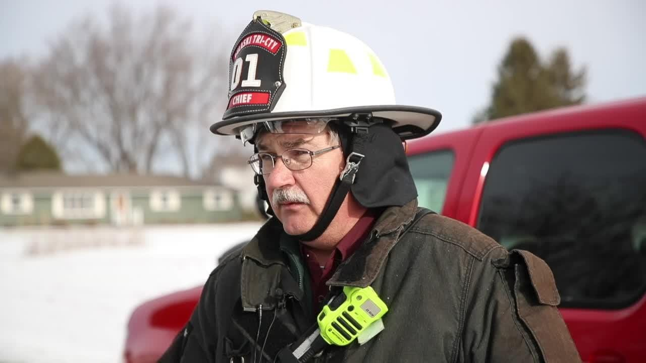 Pulaski Fire Chief James Styczynski details a house fire Friday on County Highway B just east of Pulaski.