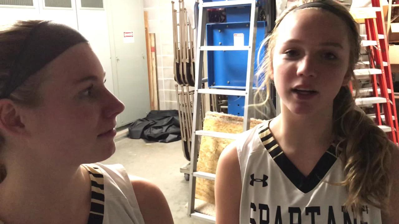 Oshkosh North's Ashley Wissink (left) and Brooke Ellestad helped lead the Spartans to their first win of the season on Friday as North topped Oshkosh West