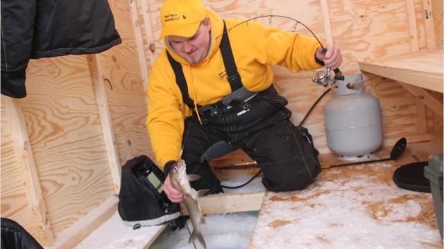 Ice fishing for lake whitefish in Green Bay