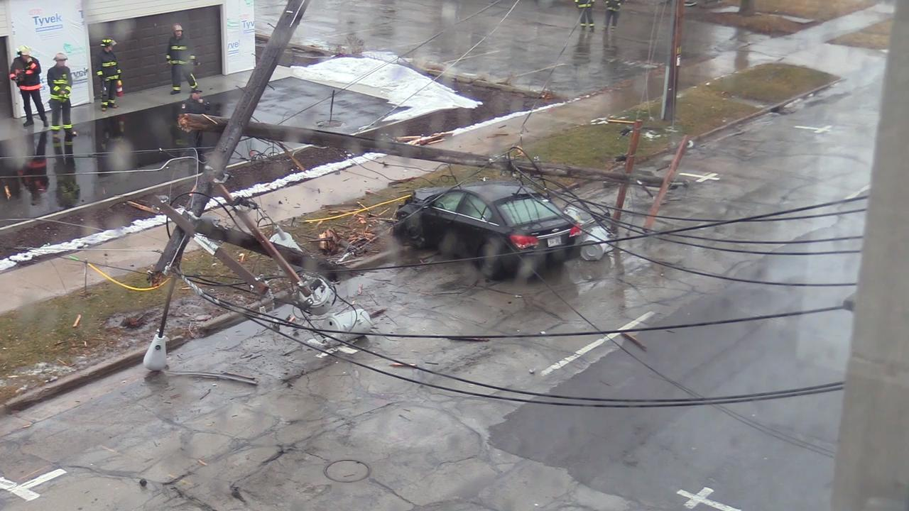 A car hit two power poles on Waugoo Ave. in Oshkosh, Wis., Jan. 22, 2018.  The driver of the vehicle walked away with only minor injuries.