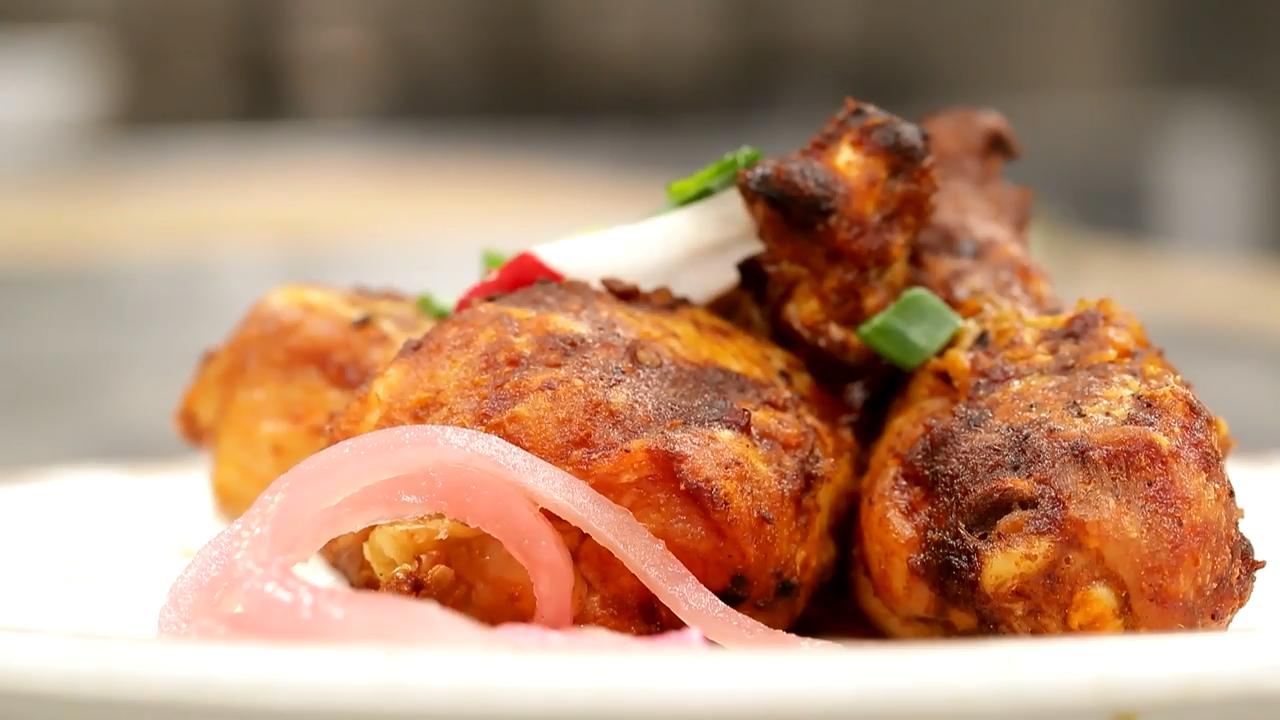 Bob Stahl, owner of ZoZo's Kitchen and ZZQ, demonstrates how to make roasted chicken legs with chipotle hot sauce.