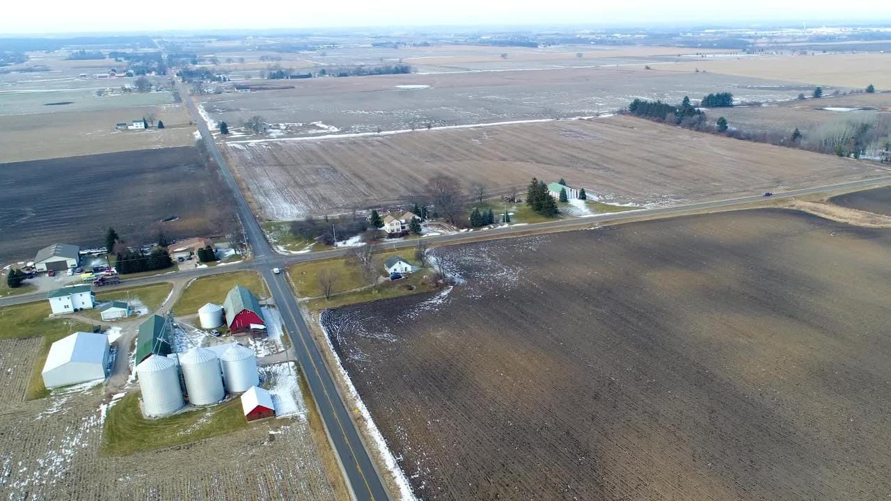 Reporter Rick Romell talks about a father and son who have become millionaires by selling their farmland for the Foxconn project. One is happy about it, the other not so much.