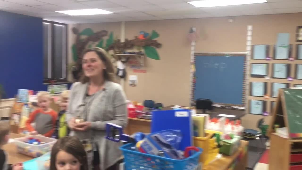 April Moran, Kindergarten teacher at Cormier School & Early Education Center in Ashwaubenon, is surprised Wednesday as a recipient of a 2018 Golden Apple award.